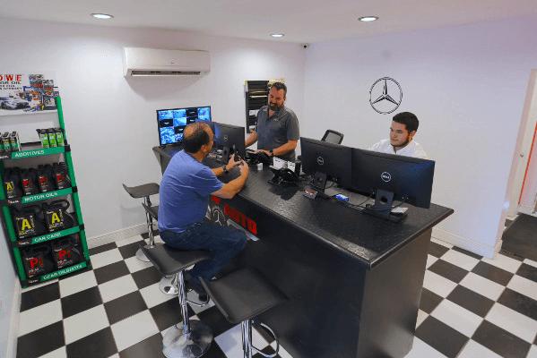 cor auto office serving customer
